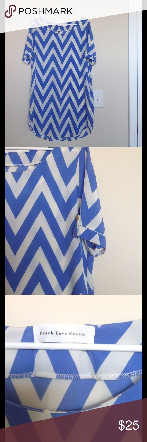 Boutique Blue Chevron Dress Size Large Only worn twice.  Super cute chevron boutique dress.   Pair with a belt and wedges for a great summer outfit! Peach Love Cream Dresses Mini
