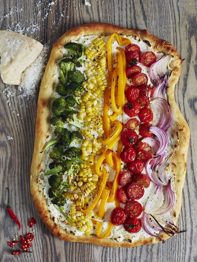 This colorful pie, loaded with every color of the rainbow, takes veggie pizza to…