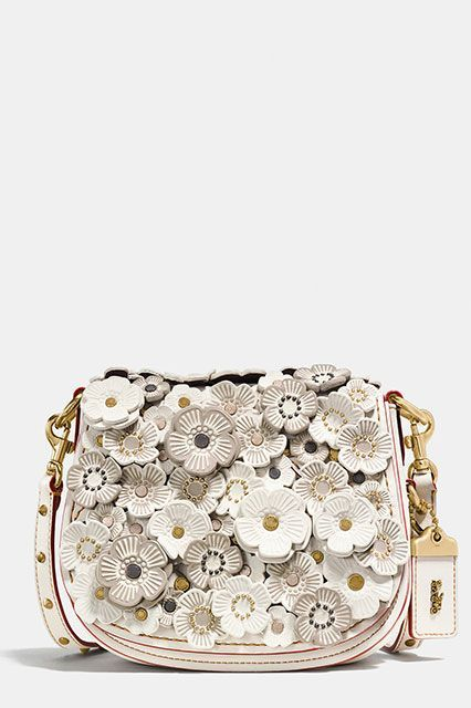 These Are The 10 Most Popular Brands For New York Women #refinery29  http://www.refinery29.com/2016/11/129129/nyc-most-popular-clothing-brands#slide-16  5. CoachThe bag company of your high school days is back and cooler than ever. Coach Saddle Blag 17 with Tea Rose Applique, $550, available at Coach...