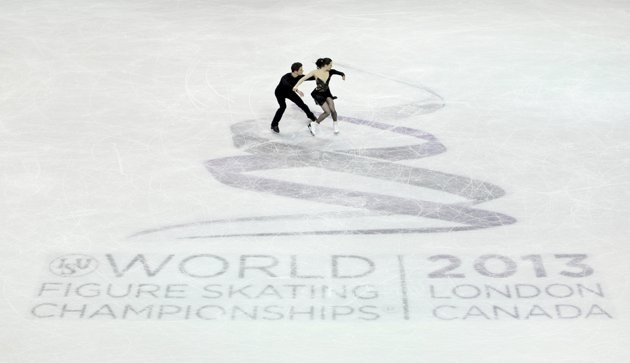 Virtue and Moir of Canada perform their ice dance free dance at the ISU World Figure Skating Championships in London, Ontario