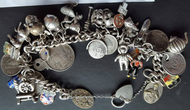 Vintage UK Hallmarked  Silver charm bracelet with 33 assorted metals and silver charms from around the world  - 85gr 3.0 ounces by FromDECOtoDISCO on Etsy