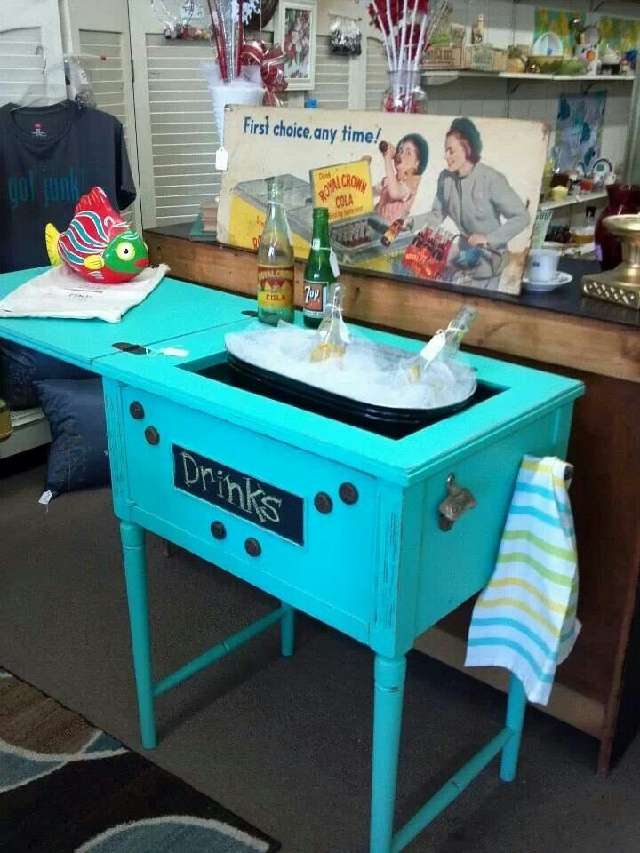 Take an old sewing machine table and convert it to a cooler.