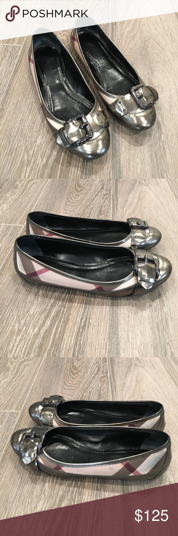 Authentic Burberry Flats Authentic Burberry flats with buckle on front and signature Burberry check details. Non slip rubber soles.  Made in Italy. EUR 38. Please note minor scuffs and blue marks from jeans rubbing on to the shoe. Overall VGUC. Original box and dust bag included. Burberry Shoes Flats & Loafers