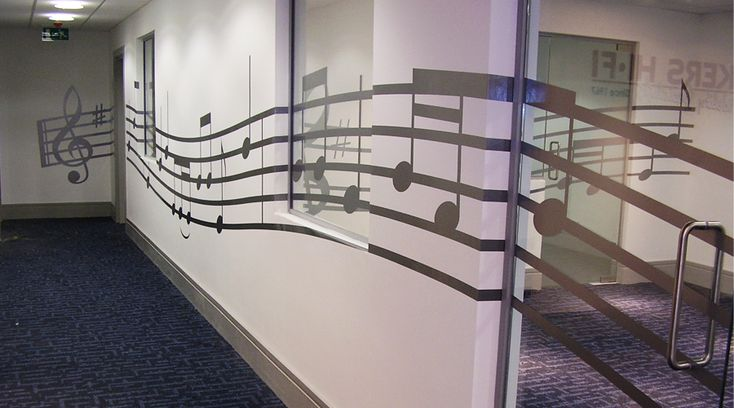 Music themed wall and glass manifestation. This music vinyl pattern was applied to both walls and glass partitions creating a flow through this office interior. By Space3.co.uk