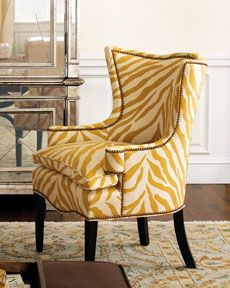 """Sunflower Zebra"" Chair     We just couldn't resist this winged accent chair decked out in a sunny zebra pattern with comfy down-filled cushions. Acrylic fabric covers chocolate-finished wooden frame. Legs are maple. 29""W x 28""D x 39""T. USA made."