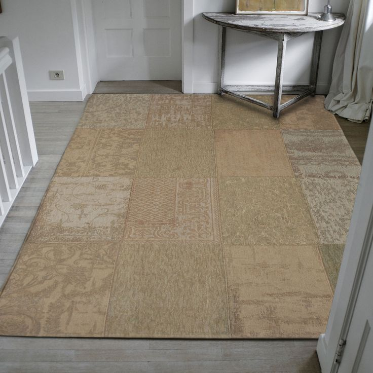 Using Faded And Muted Colours This Vintage Rug Fits Well In A Traditional Setting