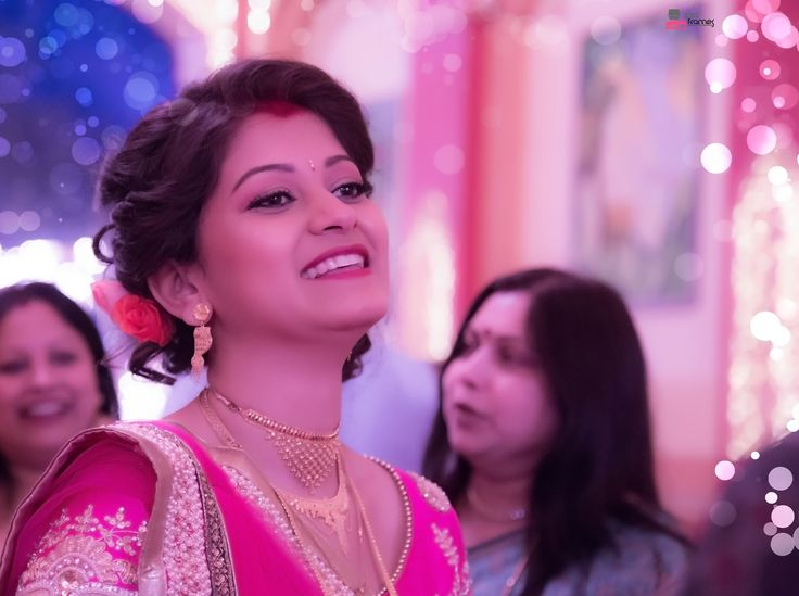 Indian Bridal Look Pretty as a princess! Bengali bride dons a beautiful cream and hot pink combo lehenga that has her twirling in happiness ♥  https://www.facebook.com/iPicFrames/  #bengalibride #indianbride || Indian Bridal Look by iPic Frames on 500px