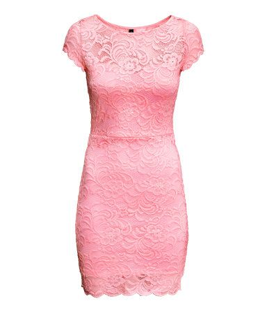Short, figure-fit dress in lace with short sleeves. Partly lined in jersey.