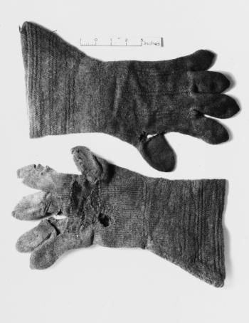 Pair of light brown knitted gauntlet gloves, found at Gunnister, Shetland