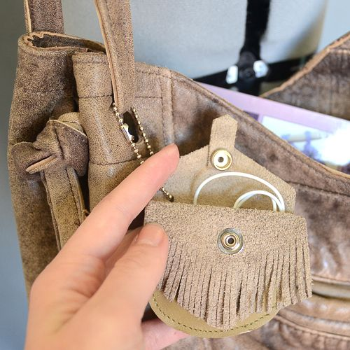purse pouch for your earbuds when traveling!  great idea.  definitely making myself one, but without the fringe.