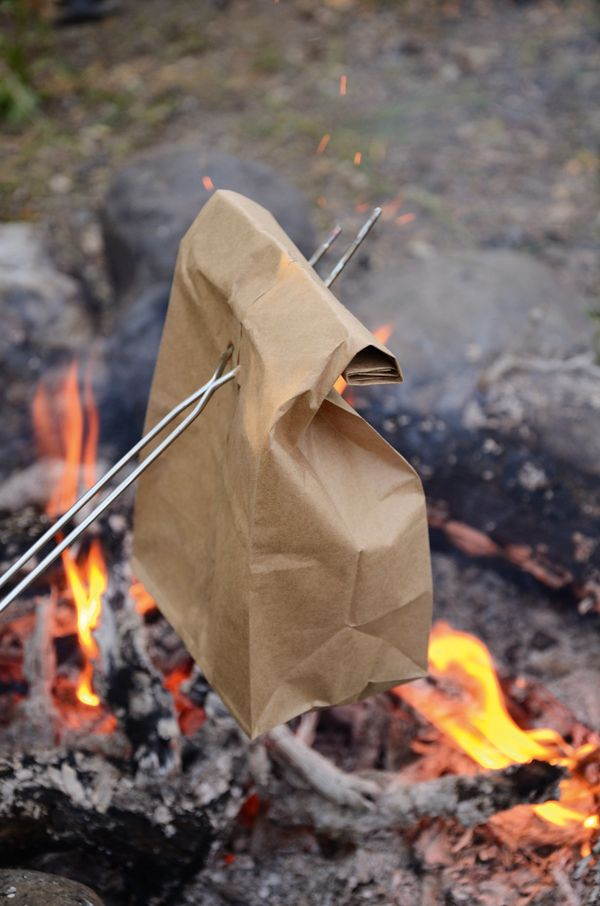 Channel your inner outdoorsman with this simple brown bag breakfast recipe of bacon, eggs and hash browns cooked over the campfire. data-pin-do=
