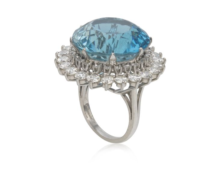 AQUAMARINE AND DIAMOND RING Set with a circular-cut aquamarine, surrounded by round diamonds, mounted in platinum  Metal: Platinum Diamonds: 46 round diamonds with approximate total weight of 3.25 - 3.75 carats  Stones: 1 round aquamarine measuring approximately 21.5 x 14.50 mm Size/Dimensions: US ring size 8  Marks: PLATINUM Gross Weight: 21.0 grams