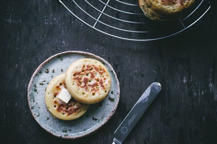 If you ever thought crumpet was just a funny word for English muffin, think again.Izy HossackfromTop With Cinnamonis illuminating the difference between the two breakfast breads and sharing a recipe for a proper British crumpet.