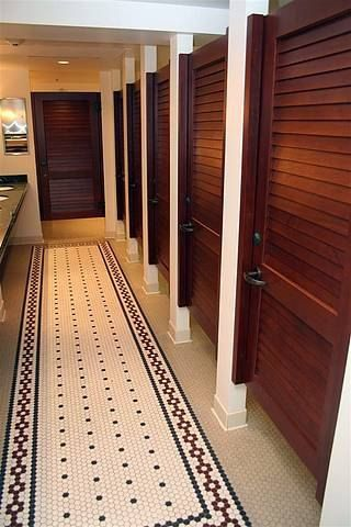 Bathroom Stalls with wood doors. Floor tile same style we'll have at WORKUP.