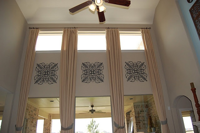 the wall hangings b/w the upper and lower windows. Not sure about the panels in between for the new house.