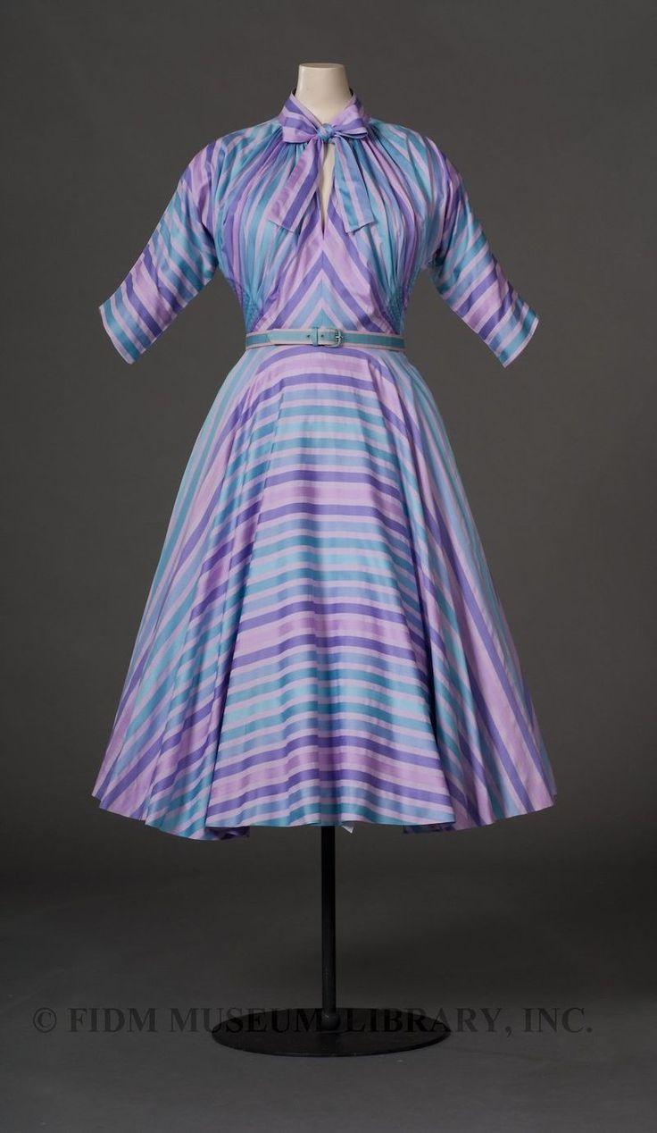 Something like this, with a different approach to the sleeves. I also am not too sure how my boobs would work with pin tucks (darts usually the best option for me, though it'd be interesting to see...) I'd love a dress I could wear on a day-to-day basis... [Day dress, by Claire McCardell  c. 1950, FIDM Museum]