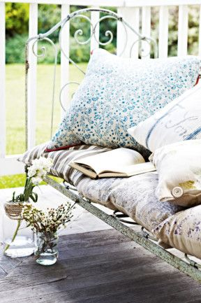 8. Look at an old bed frame in a new way. This rustic frame has been converted into a dreamy daybed with the addition of...