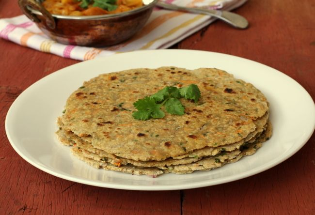 Oats Roti (paratha) prepared with whole wheat flour, oats and spices. Try cooking with oats, a healthy Indian recipe that kids will enjoy with tomato sauce.