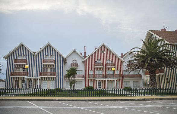 Striped Houses of Costa Nova, Portugal }{ A short drive from Aveiro you discover a beach where the charm of many wooden houses with colorful stripes is quite exceptional. Besides the 'haystacks', the name for these wooden stripped houses, Costa Nova is also one of the great Portuguese beaches for water sports, wind surfing and  kite surfing.