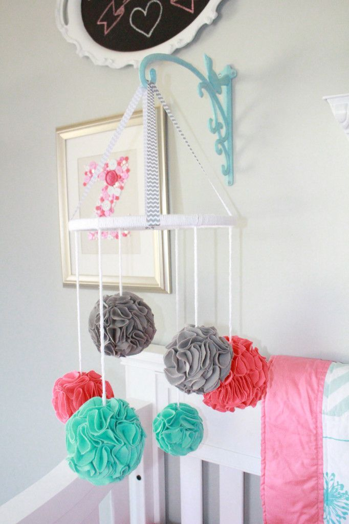 Project Nursery - Pom Pom Baby Mobile -- plant holder thing for attaching mobile