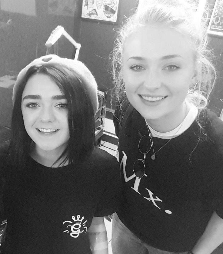 Sophie Turner and Maisie Williams are back in Northern Ireland and having a ball around town, it seems. The Stark sisters were spotted several times in Belfast today, shopping and taking photos with fans. They even visited a tattoo parlor together. There's no word on if both actresses got ink today, but that does look like a bandage/wrap for a fresh tattoo on Maisie's left arm. Hopefully that heals in time for the Emmys next Sunday!