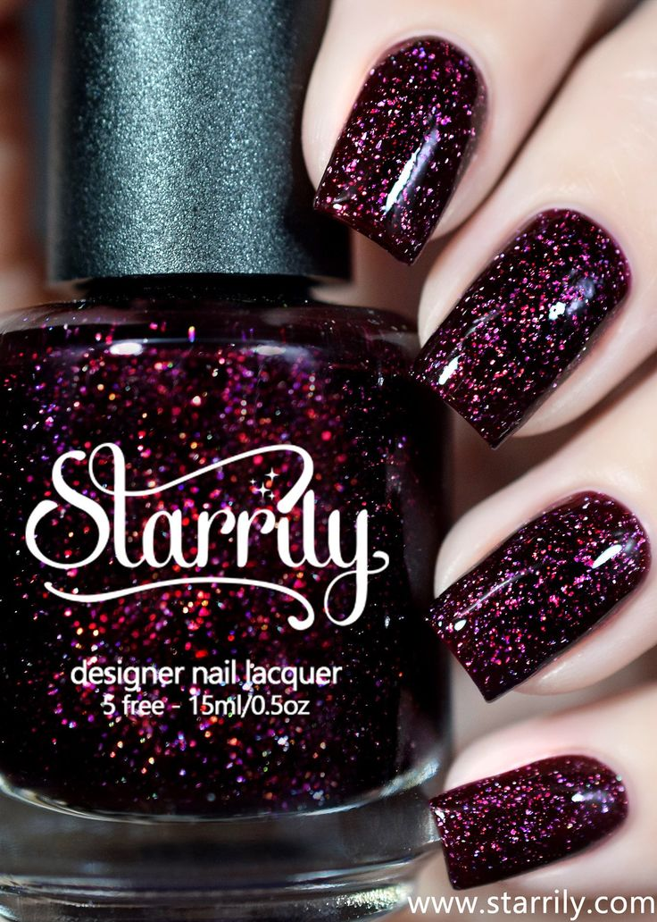 Oxytocin is a beautiful dark red maroon nail polish with holographic flakes