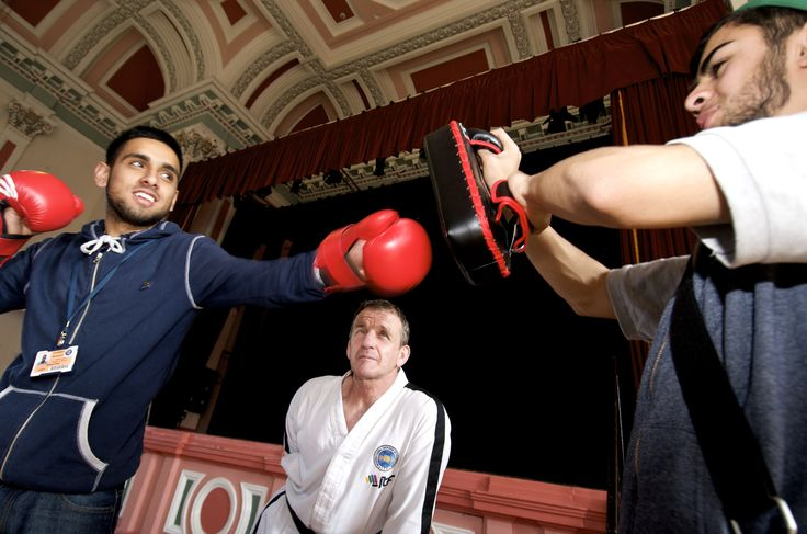 Students getting put through their paces by a local boxing instructor.
