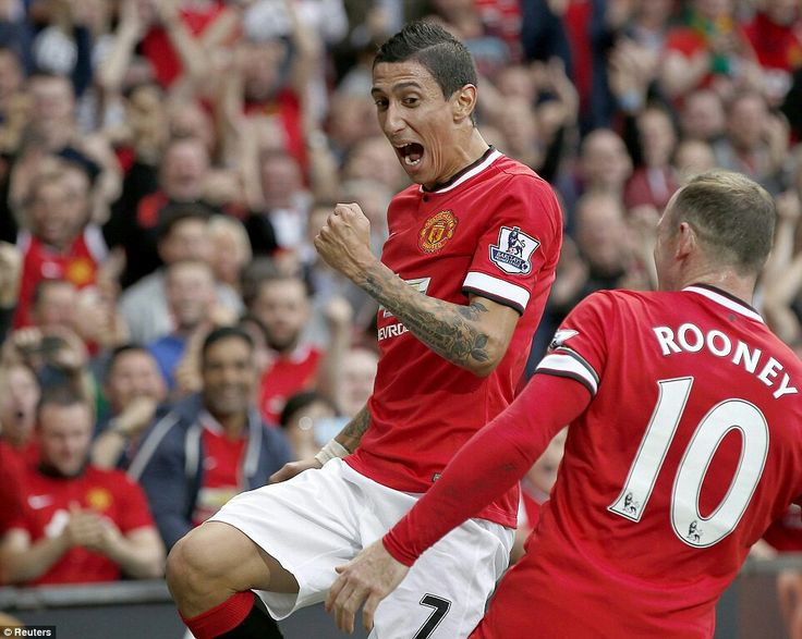 Angel di Maria celebrates his first goal for Manchester United with Wayne Rooney