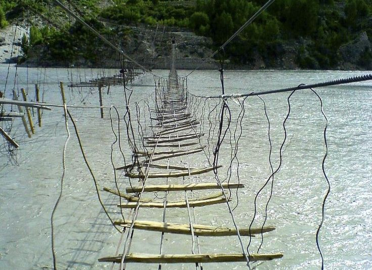 Hussaini Hanging Bridge, Pakistan It is one of the most dangerous bridges in the world. With the rungs spread sporadically, the journey across the water isn't easy. The dangerous trek across is performed every day by those in the community.