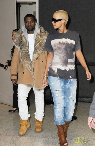 Kanye West spotted wearing his unique style of skinny jeans standing with girlfriend Amber Rose.