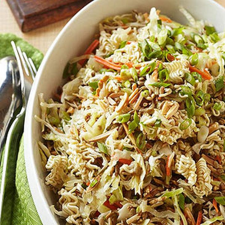 Oriental Coleslaw Recipe Salads with shredded cabbage, green onions, ramen noodles, slivered almonds, nuts, salad oil, vinegar, sugar, ground black pepper, green onions