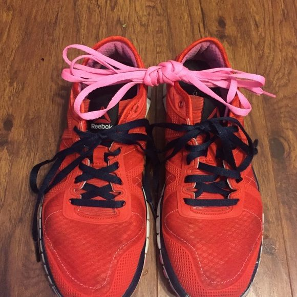 Red Crossfit shoes Good condition. These were my first pair of Crossfit shoes worn about 3 months. They are perfect for every movement. They come with an extra pair of laces. Reebok Shoes Sneakers