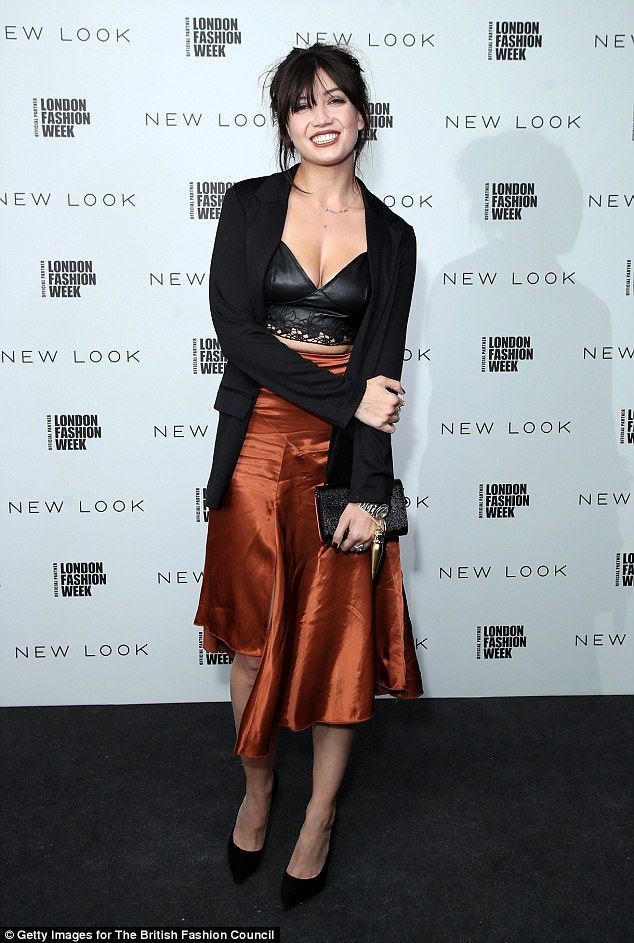 Incredible: The tiny number was paired with a high-waisted bronzed satin skirt, which featured a waterfall hem, and flashed a peek of her toned legs