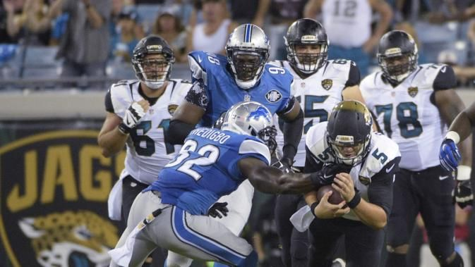 Jacksonville Jaguars quarterback Blake Bortles (5) runs before being brought down by Detroit Lions strong safety James Ihedigbo (32) during the first half of an NFL preseason football game in Jacksonville, Fla., Friday, Aug. 28, 2015. (AP Photo/Phelan M. Ebenhack)