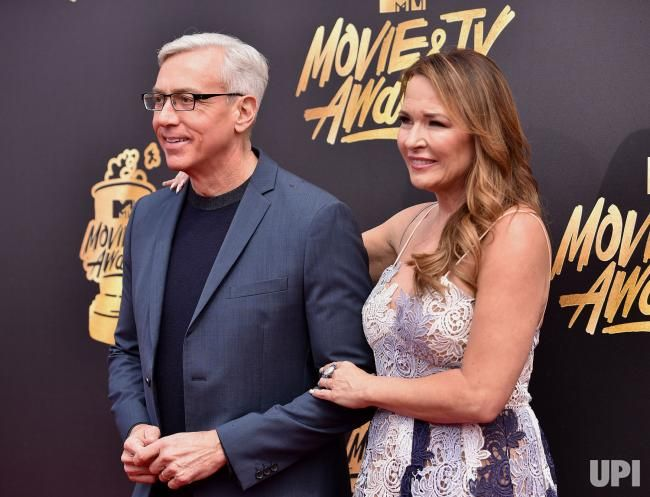Dr. Drew Pinsky (L) and Susan Pinsky attend the MTV Movie & TV Awards at the Shrine Auditorium in Los Angeles on May 7, 2017. It will be…