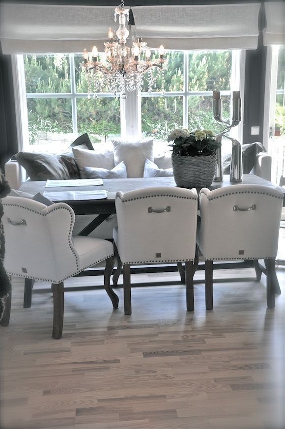 Love the chairs.....gray and white makes for a sophisticated space.