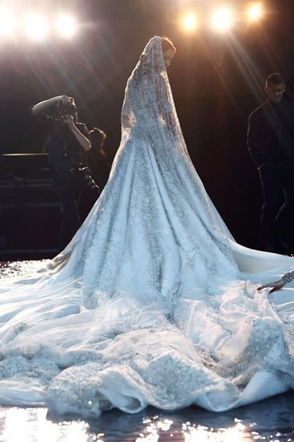 The bride of Ralph&Russo at @HauteCoutureWk Disney Inspired Wedding . Frozen ' s Elsa  wedding dress . Long Veil