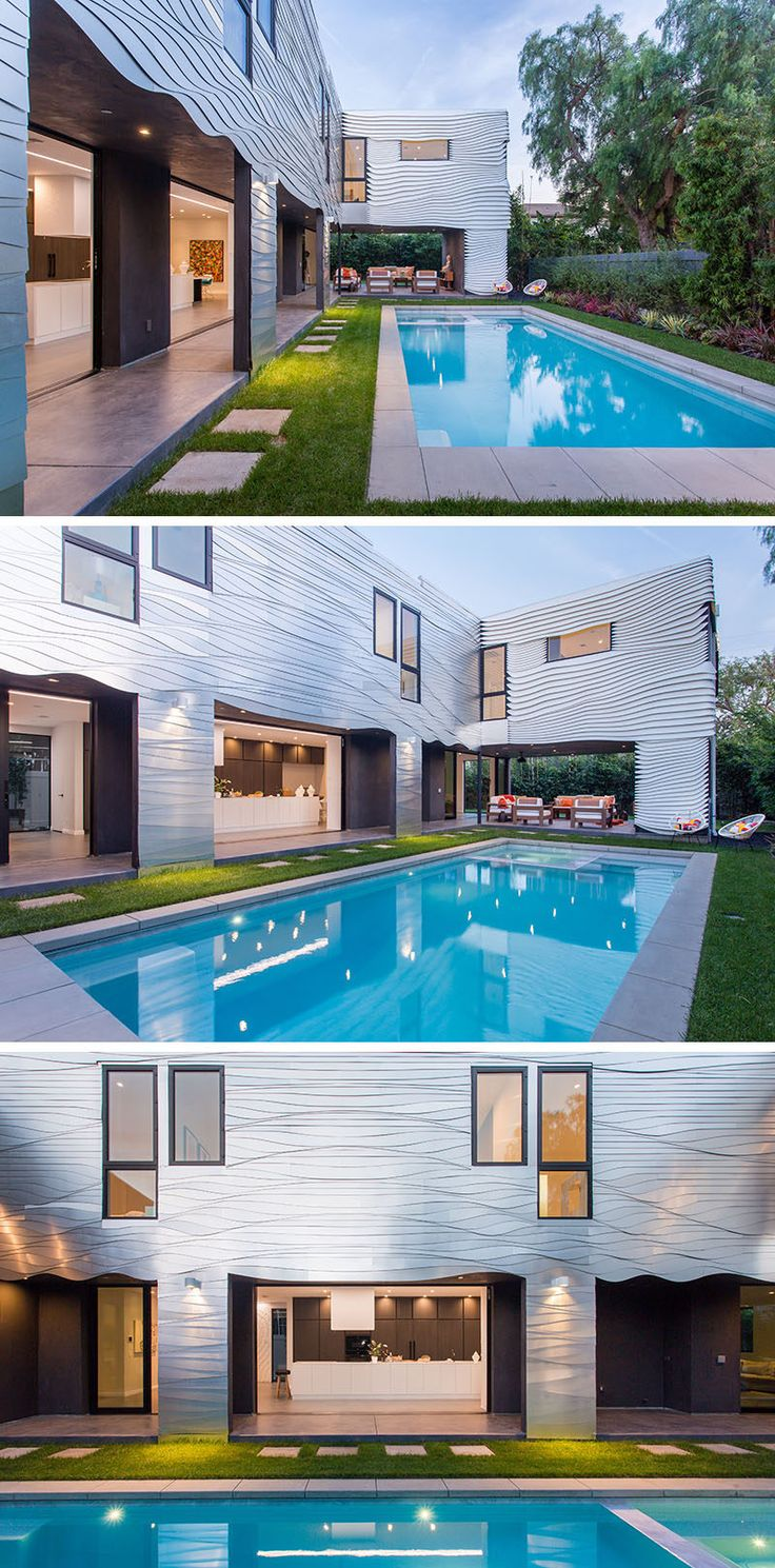 This modern house partially wraps around the swimming pool and many of the interior spaces open up to the outdoors.