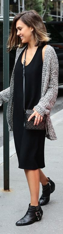Who made  Jessica Alba's gray cardigan sweater, ankle boots, and black handbag?