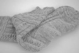 New Zealand Polwarth fleece handspun in worsted yarn and handknit into gansey style socks