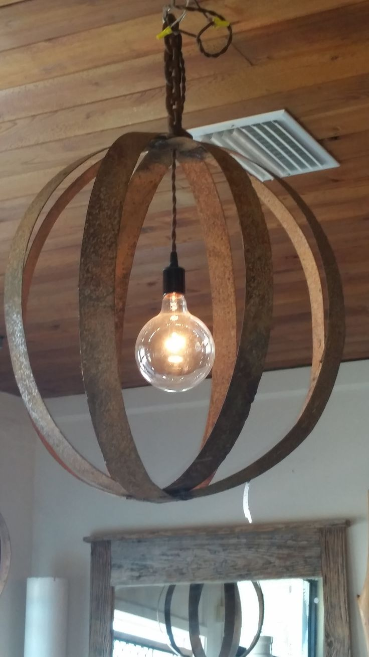 whisky barrel rings re-purposed into  a light