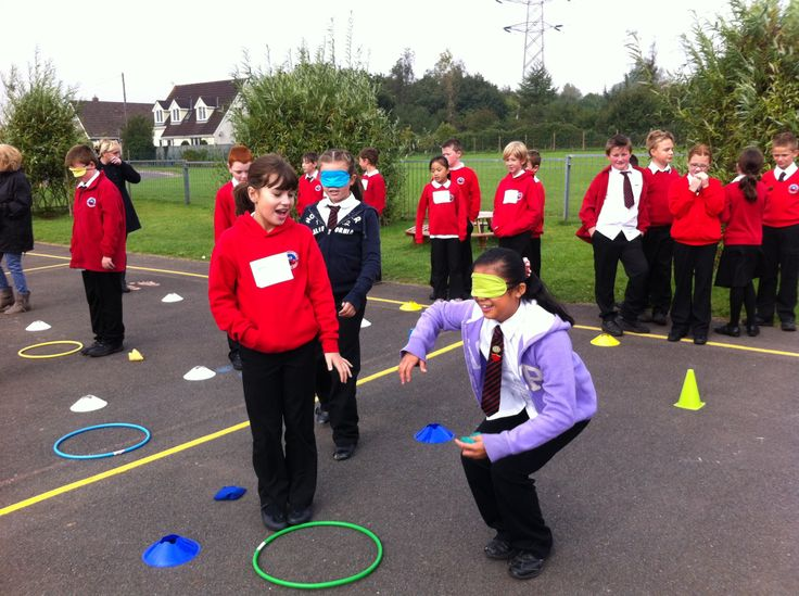 Primary pupils learning the principles of computing in the playground