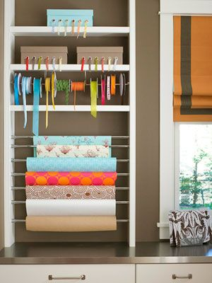 Transform an open bookcase into a crafts and gift-wrapping station. Slip rolls of paper over tension rods and stretch to secure between the bookcase's framework. Tuck standard-size ribbons into boxes and string extra-wide ribbon rolls onto a dowel rod supported by brackets to keep pretty trims at the ready.