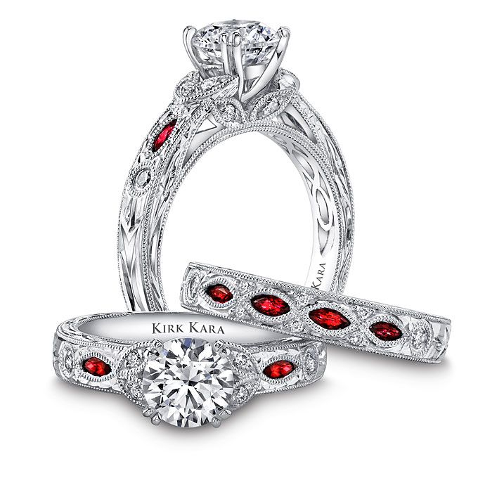 Brides.com: . Hand engraved 18k white gold engagement ring with diamonds and marquise cut rubies, $2,720 (setting only), and matching wedding band, $2,160, both Kirk Kara Dahlia collection