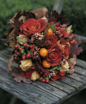 oak leaves, roses, cape gooseberries, hypericum berries, kumquats and skimmia flowers