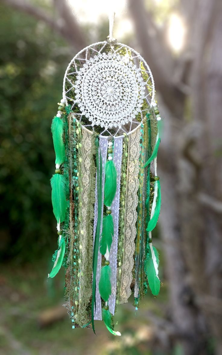 Dreamcatcher, boutique vintage style Dream catcher, beautiful hand made crochet doilies, freshwater pearls, lace, charms & natural feathers. by HeavenlyEarthArt on Etsy https://www.etsy.com/listing/227138797/dreamcatcher-boutique-vintage-style