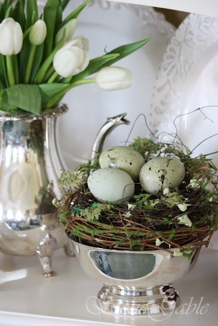 Blue green eggs, wood and moss tones of a nest, glimmer of silver and the elegance of simple white flowers
