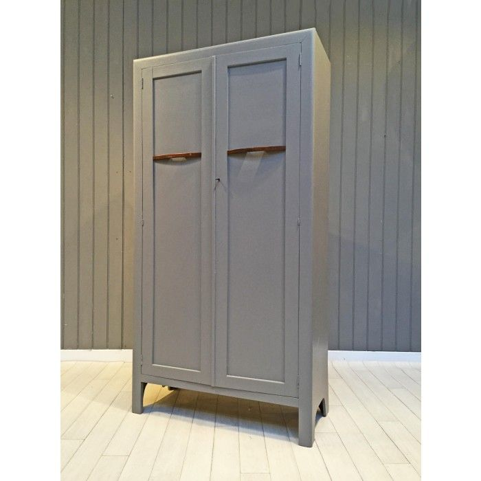 This oak wardrobe has been painted in Farrow and Ball's 'Mole's Breath' for a contemporary look. There is a rail on the left and drawers and shelving on the right.