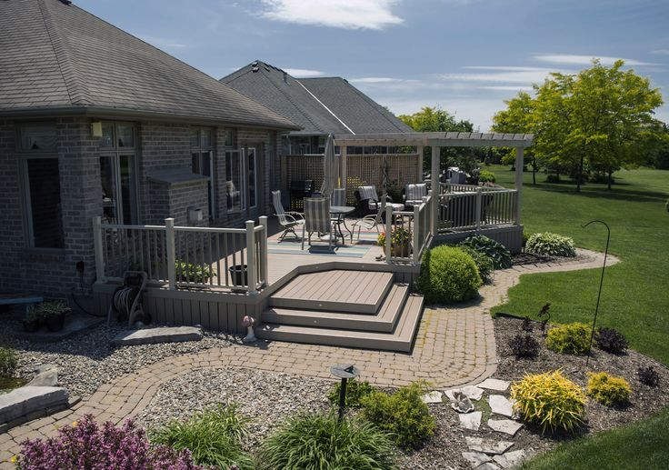 This custom low maintenance deck was built in Petrolia Ontario using Palram vinyl decking.