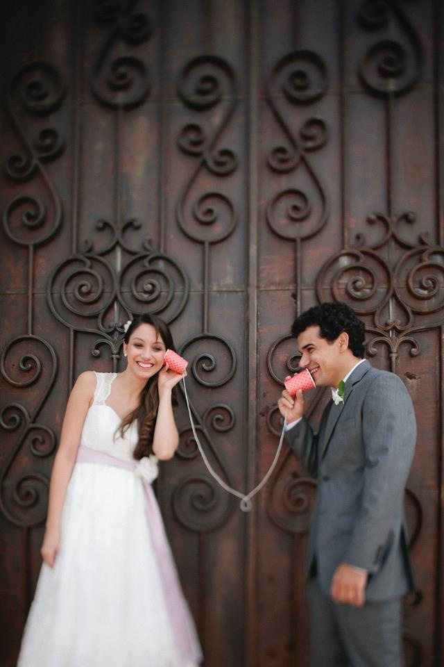 tin can telephone, made with paper cups with a heart pattern - FUN Brazilian Wedding!  http://www.frankieemarilia.com